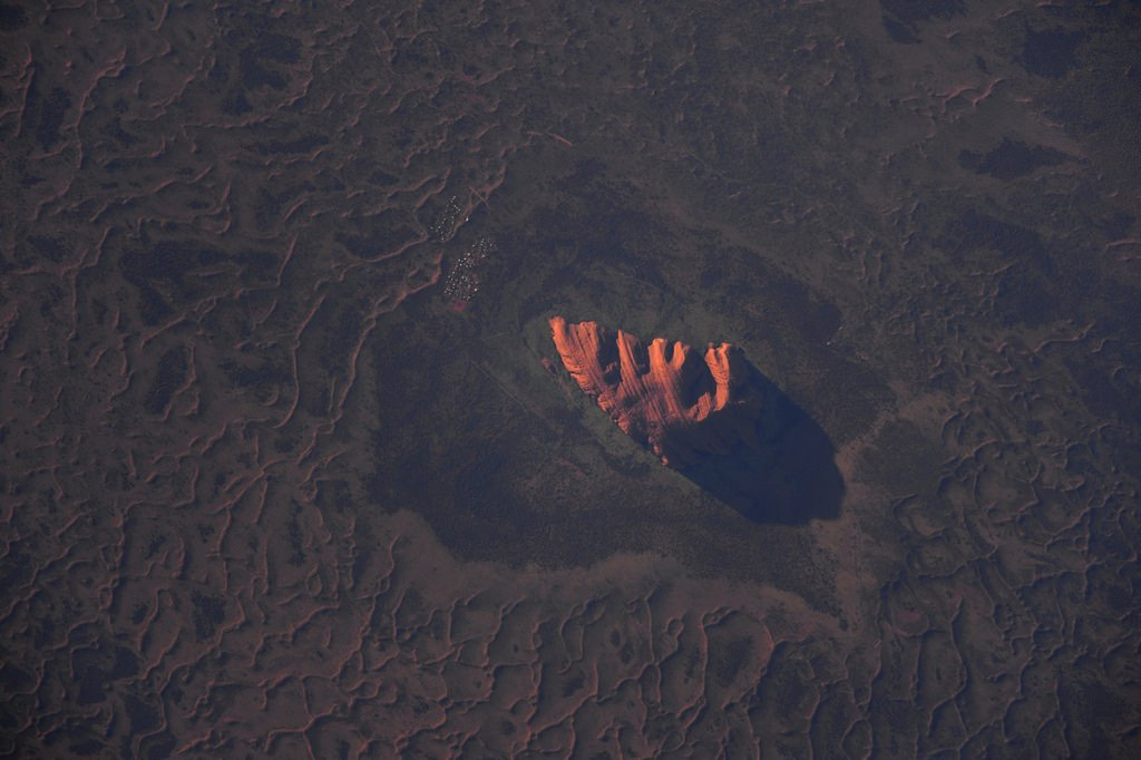 Here is a picture I?ve wanted to take for a long time: Ayer?s rock in Australia (also named #Uluru in aboriginal)   (Photo & Caption: Thomas Pesquet // NASA)