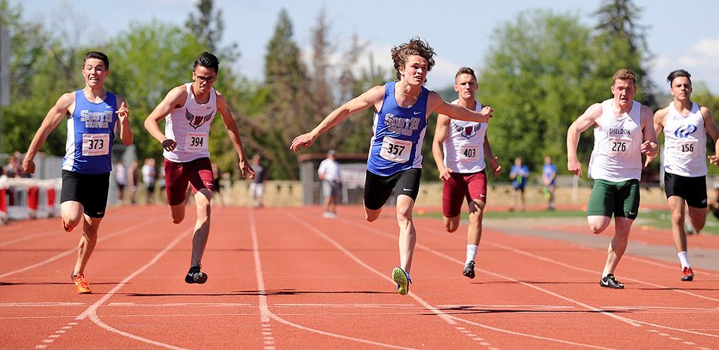 Andy Atkinson / Mail TribuneSouth Medford's Austin Boster (357) crosses the line winning the 200-meter run with teammate Peyton Shipley (373) finishing 2nd at the SWC Championships meet at North Medford High School Saturday.