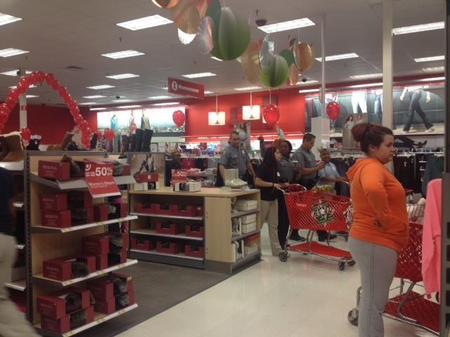 OKCP officers are shopping with kiddos at target as part of Heroes and Helpers
