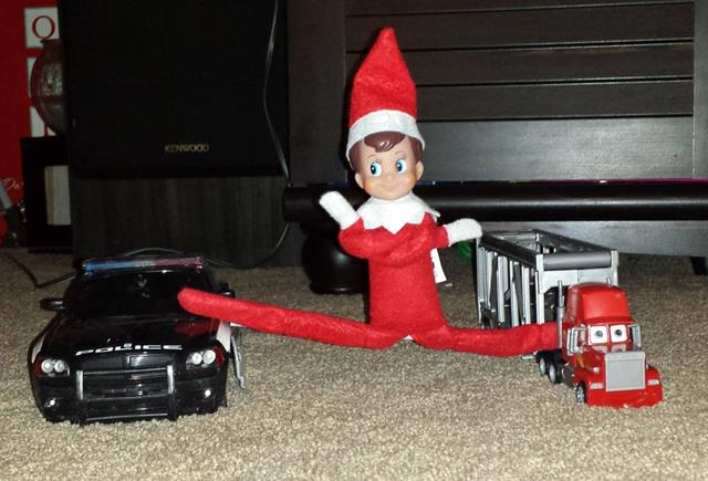 Our elf, Mr. FrostyPants...imitating Jean Claude VanDamme