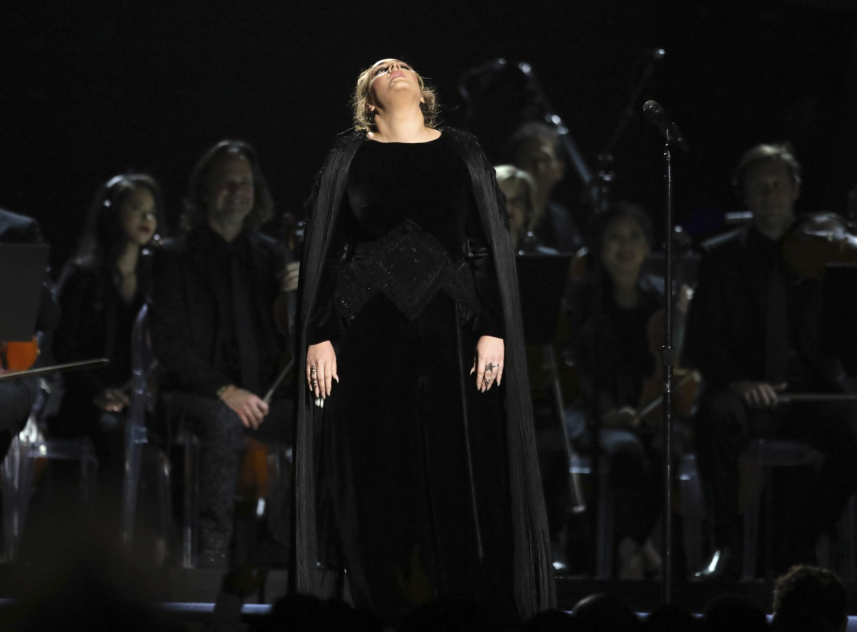 Adele reacts before restarting a performance tribute to George Michael at the 59th annual Grammy Awards on Sunday, Feb. 12, 2017, in Los Angeles. THE ASSOCIATED PRESS