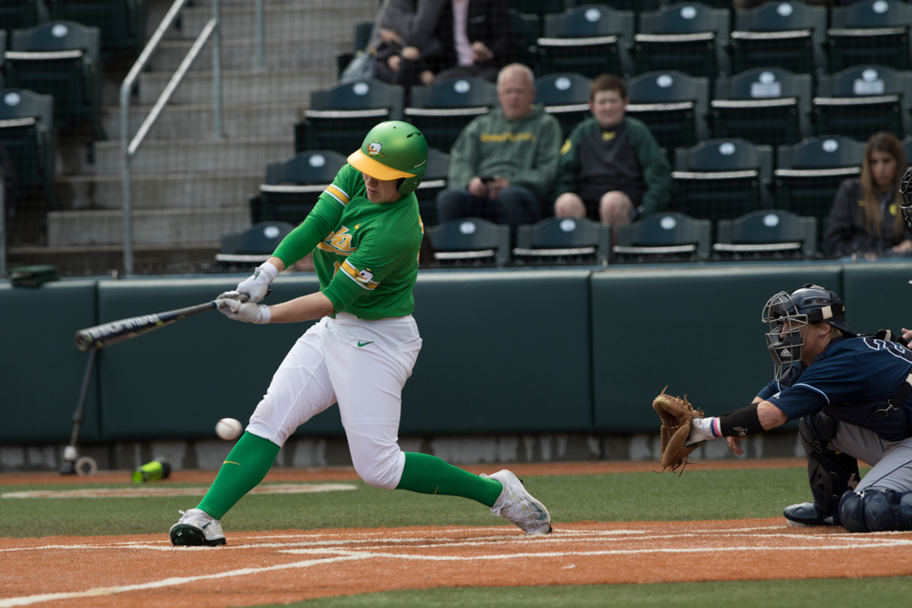 Oregon Ducks infielder Gabe Matthews (#12) misses on a swing against the UC Irvine Anteaters. In the second of the three game series, the Ducks beat the UC Irvine Anteaters 6-3. Photo by Austin Hicks, Oregon News Lab