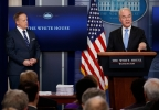White House press secretary Sean Spicer listens at left as Health and Human Services Secretary Tom Price speaks during the White House press briefing, Tuesday, March 7, 2017, in Washington. (AP Photo/Evan Vucci)