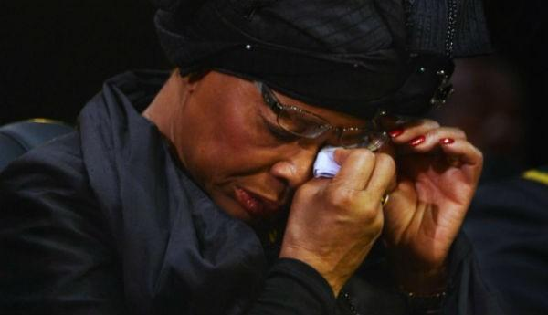 Mandela's widow Graca Machel wipes her eyes during the ceremony.