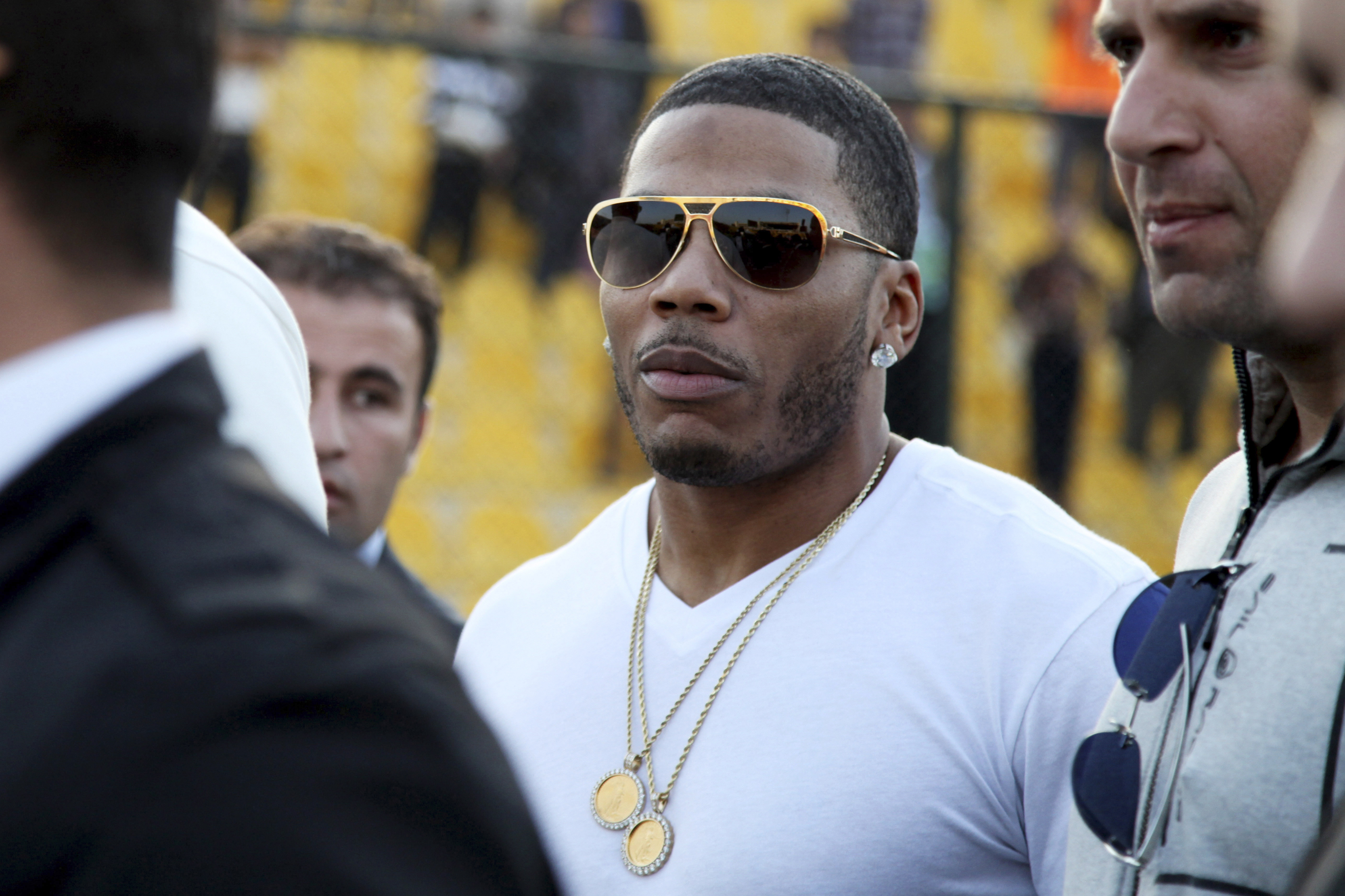 FILE- In this March 13, 2015, file photo, rapper Nelly approaches the stage for a concert in Irbil, northern Iraq. Prosecutors in Washington state say they cannot proceed with a rape case against the rapper Nelly because the accuser is not cooperating. The woman said Nelly raped her on his tour bus in October in a Seattle suburb, and police arrested him. Prosecutors said Thursday, Dec. 14, 2017, that they've reviewed the investigation, but without the woman's help, they can't move forward with the case. (AP Photo/Seivan M. Salim, File)