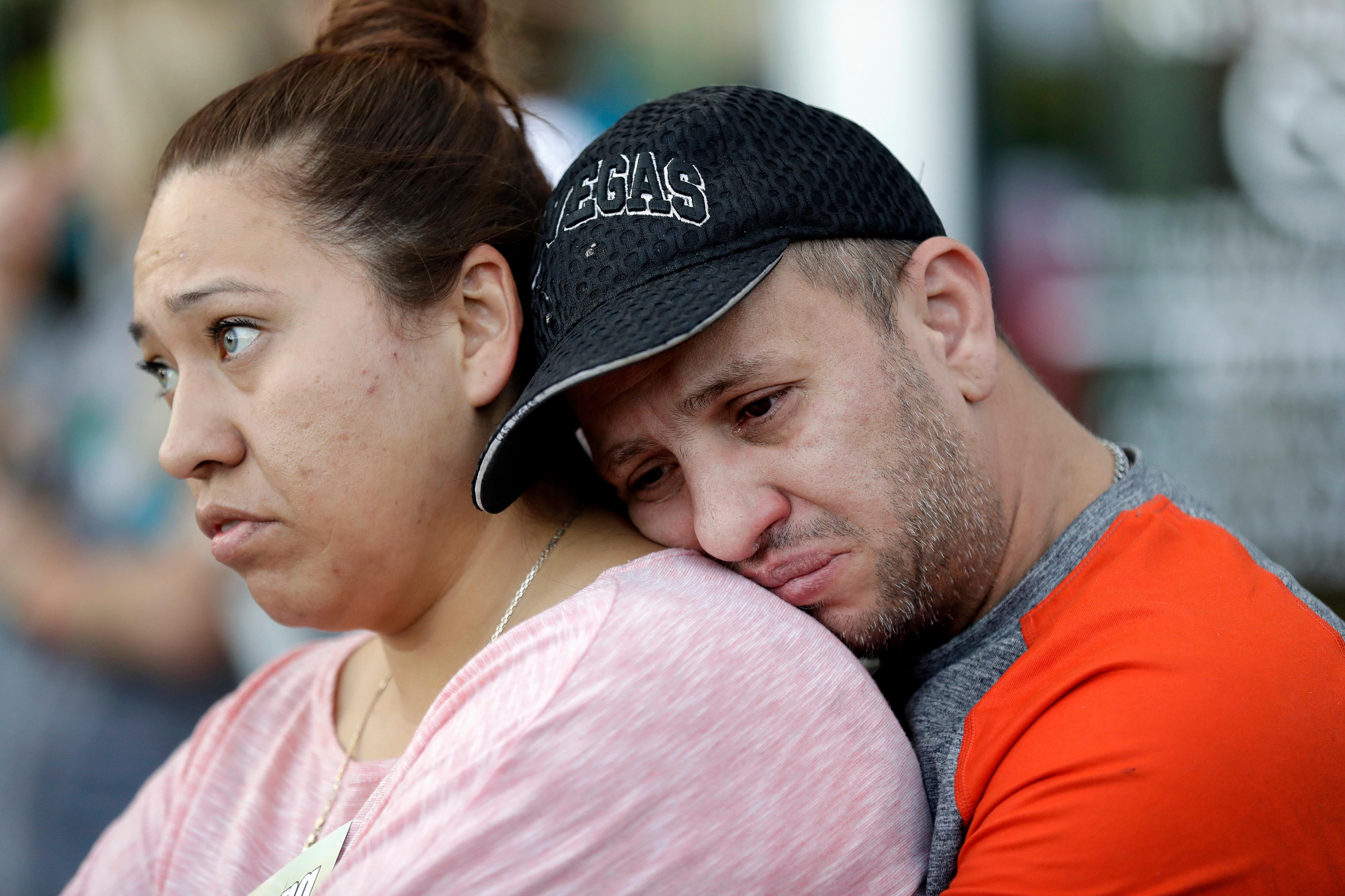 Rosa and Alan Duarte become emotional during a vigil at City Hall in Las Vegas, Monday, Oct. 2, 2017. The vigil was held in honor of the over 50 people killed and hundreds injured in a mass shooting at an outdoor music concert late Sunday. (AP Photo/Gregory Bull)