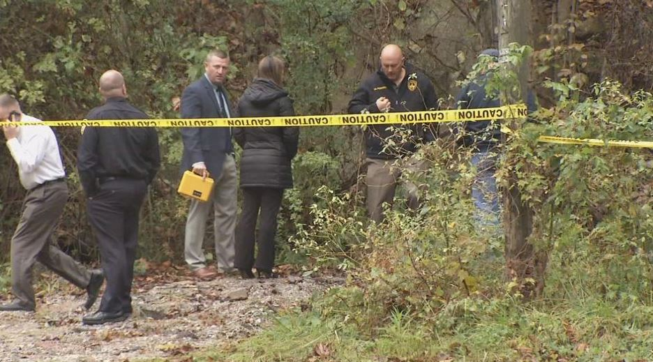 Police investigate the scene where a dead body was found Wednesday. (WCHS/WVAH)<p></p>