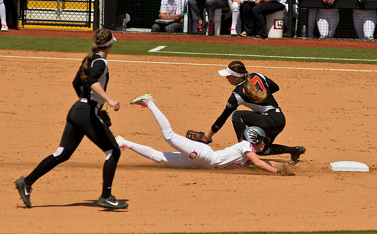 Oregon Ducks Alexis Mack (#10) is tagged out by Oregon State Beavers short stop McKenna Arriola (#27). The Oregon Ducks defeated the Oregon State Beavers 7-2 in game two of the three-game Civil War series at Jane Sanders Stadium on Saturday. The final game of the series will be on Sunday at 3:00 p.m. at Jane Sanders Stadium. Photo by Dan Morrison, Oregon News Lab
