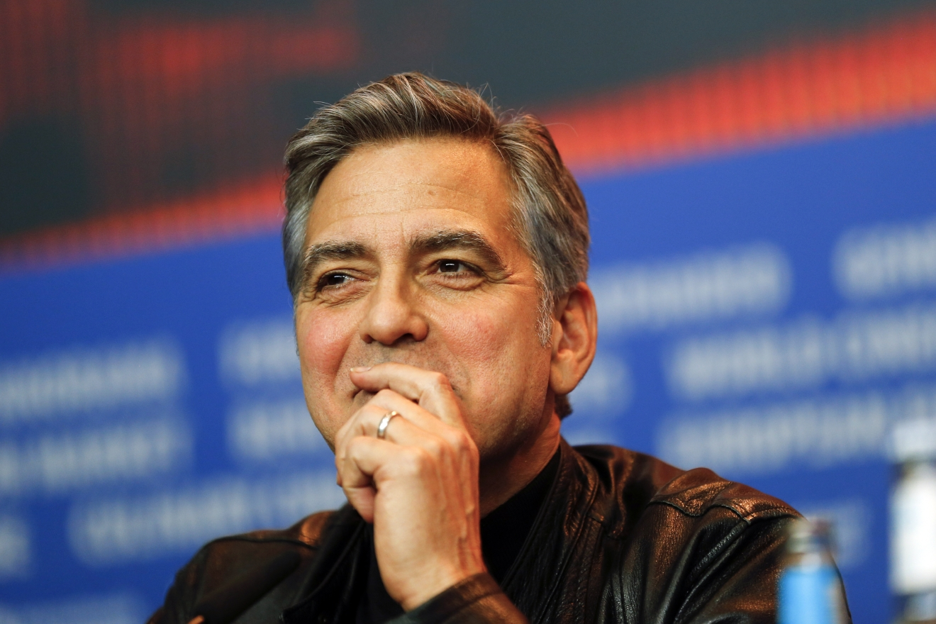 FILE - In this Thursday, Feb. 11, 2016 file photo, actor George Clooney attends a press conference for the film 'Hail Caesar' at the 2016 Berlinale Film Festival in Berlin, Germany.  (AP Photo/Axel Schmidt, file)
