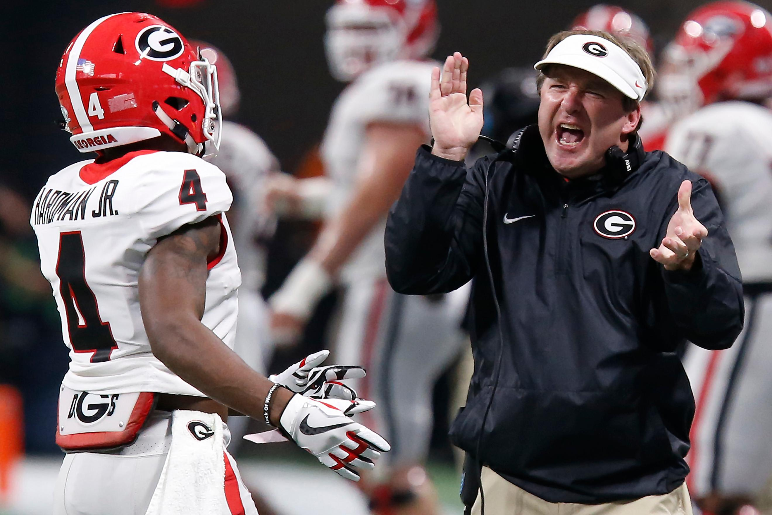 Georgia coach Kirby Smart applauds wide receiver Mecole Hardman (4) during the first half against Auburn during an NCAA college football game for the Southeastern Conference championship, Saturday, Dec. 2, 2017, in Atlanta. (Joshua L. Jones/Athens Banner-Herald via AP)