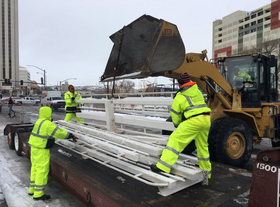 City of Reno Public Works workers remove a rail at the Lake Street bridge Saturday, January 7, 2017, in advance of projected flooding. (Photo provided by the City of Reno)