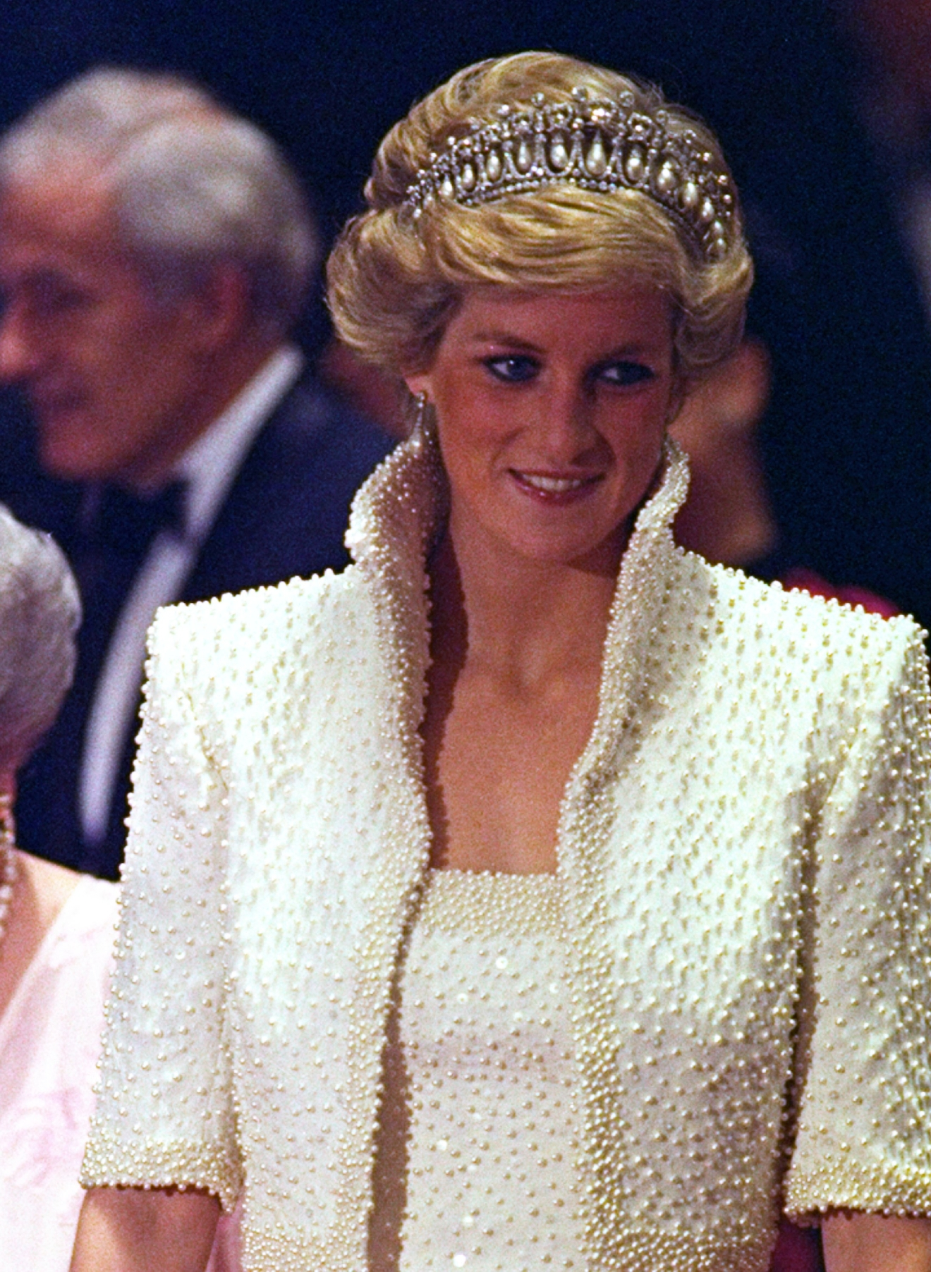"FILE - In this 1989 file photo, Diana, Princess of Wales smiles during an official visit to Hong Kong. This dress is part of an exhibition of 25 dresses and outfits worn by Diana entitled ""Diana: Her Fashion Story"" at Kensington Palace in London, opening on Friday, Feb. 24, 2017. (AP Photo/Liu Heung Shing, file)"